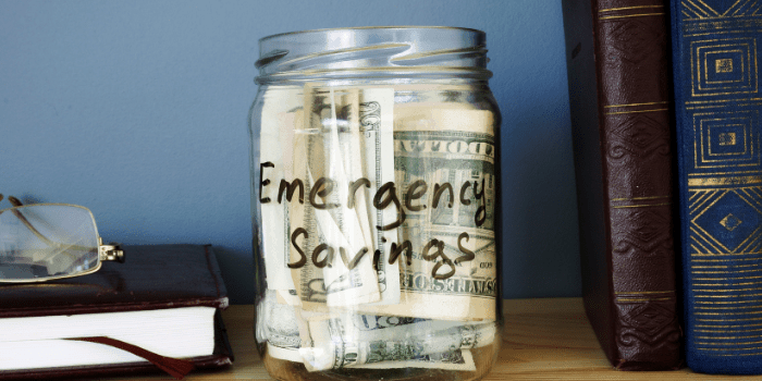 Jar with Emergency savings Cash Fund on the shelf