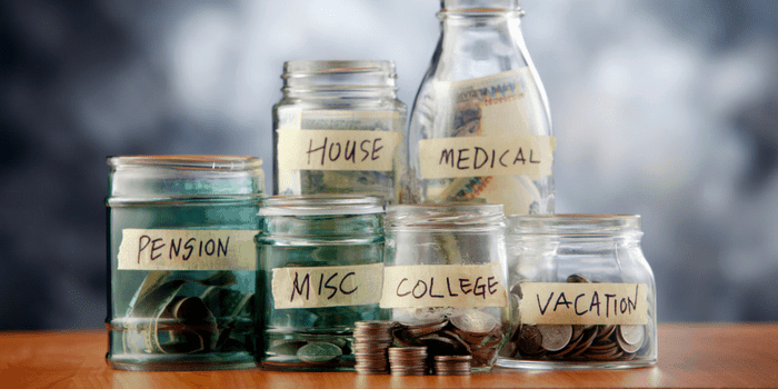 Jars of money with budget categories labelled