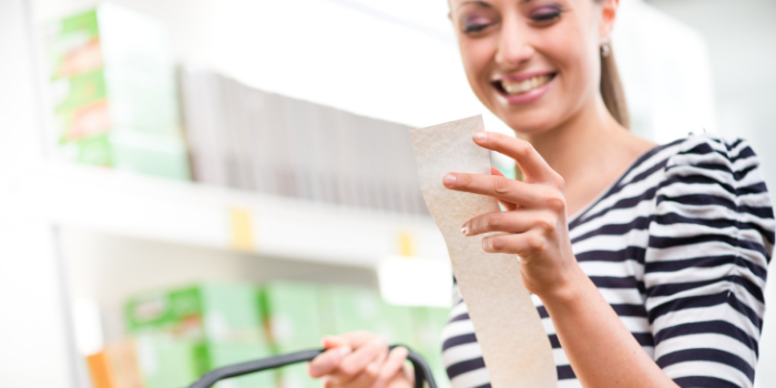 women smiling looking at grocery receipt