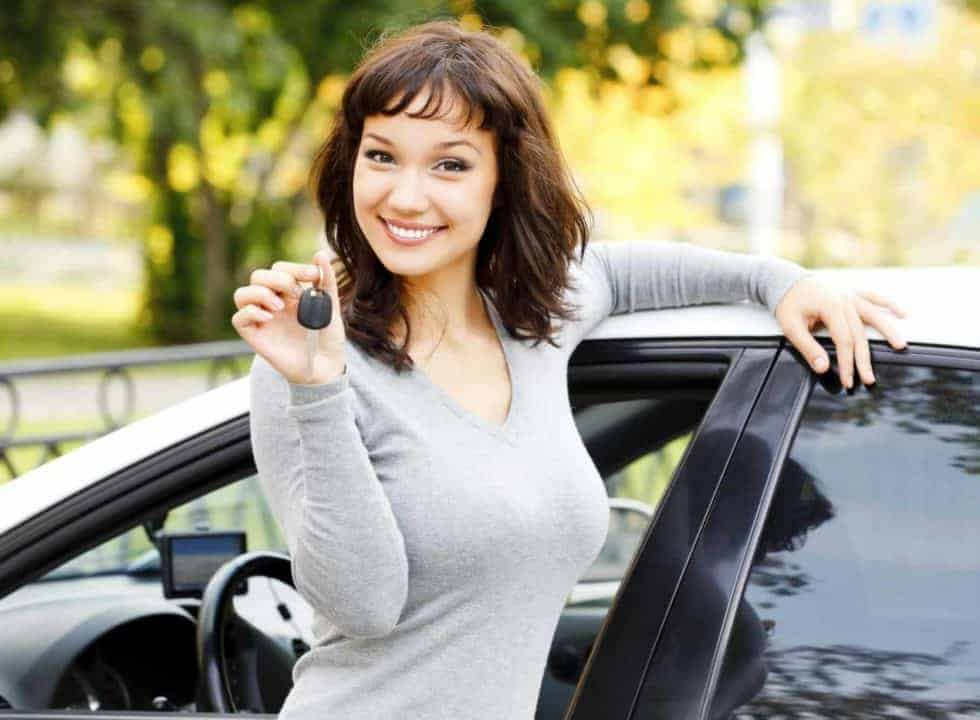 Woman holding keys to a car