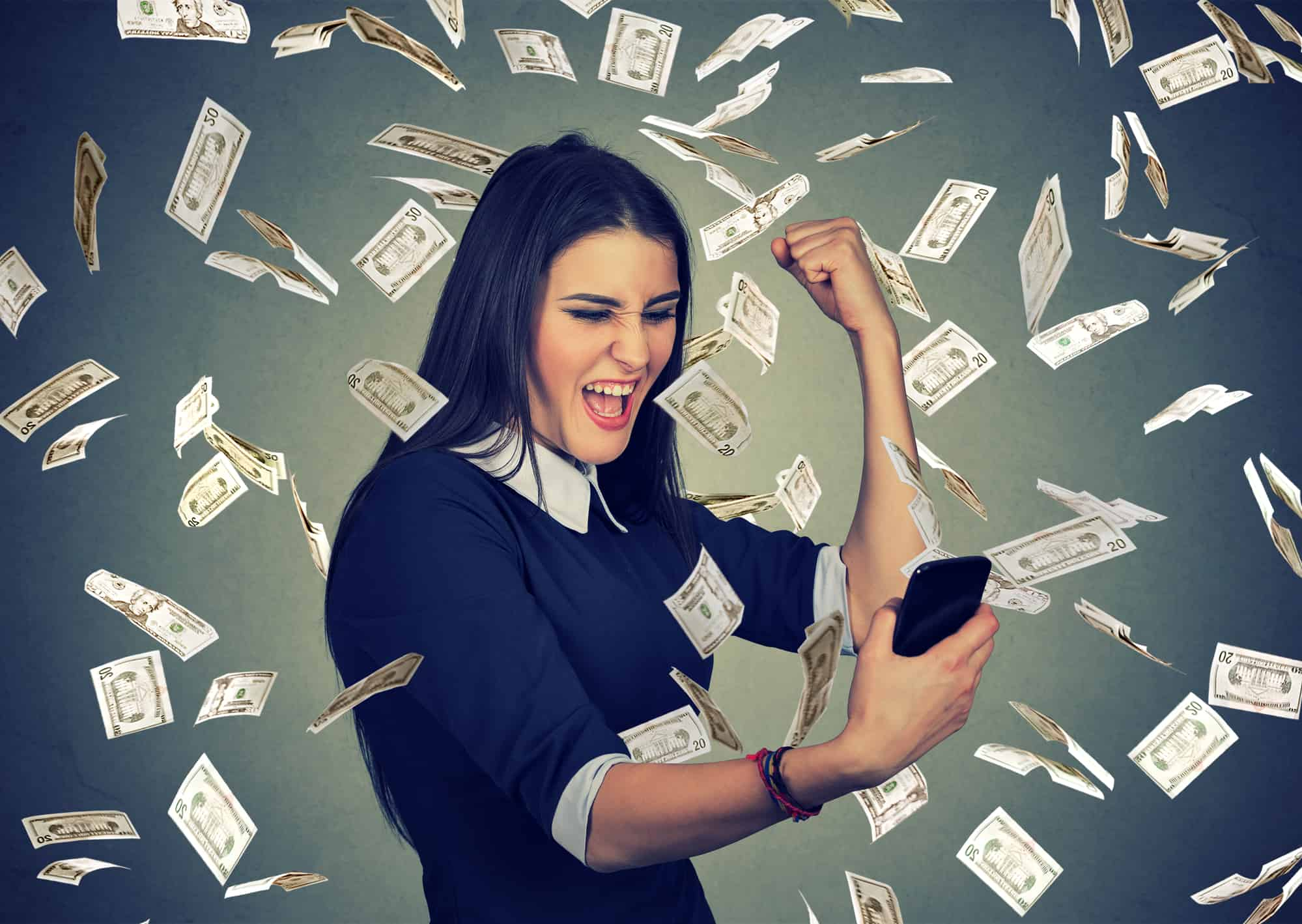 A woman standing in a shower of cash after shopping online